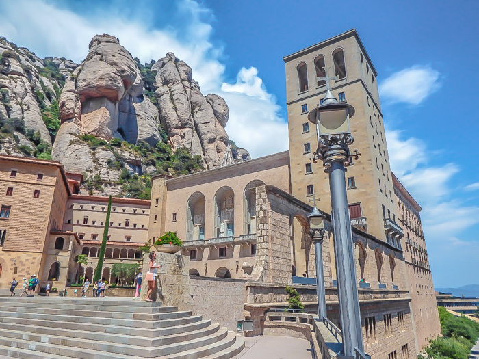 Day trip to Montserrat   4 days in Barcelona, Spain, Catalonia   Things to do in Barcelona   What to do in Barcelona   Catholic monastery   Catalunya   1 day in Montserrat   Serrated Mountains   exterior courtyard