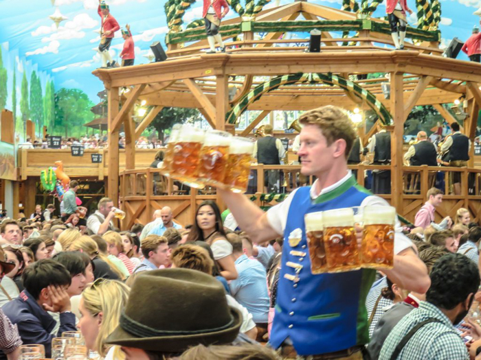 My Wanderlusty Oktoberfest Recap | What it's like at Oktoberfest in Munich, Germany | What it's like to travel to Oktoberfest with Thirsty Swagman | Oktoberfest beer tents | Oktoberfest food and beer | What to wear to Oktoberfest | Oktoberfirsts | carrying beers