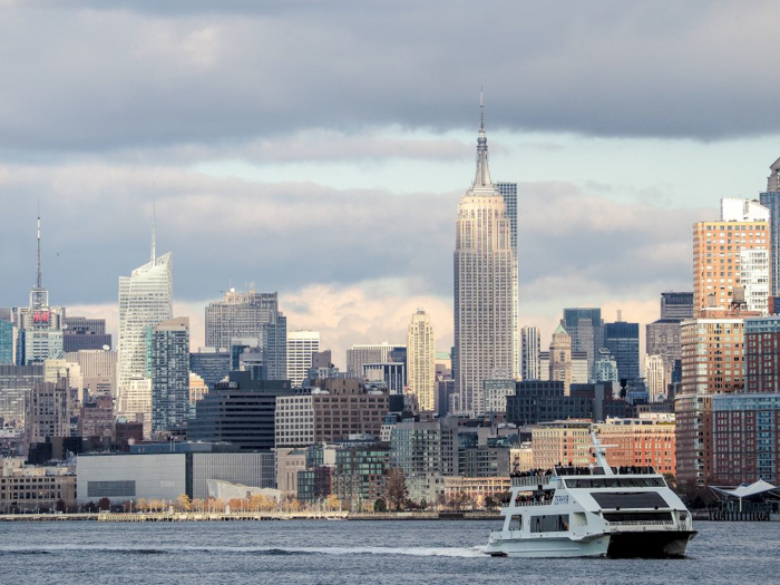 Visiting the Statue of Liberty, New York City // Empire State Building seen from the ferry