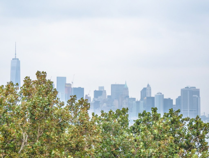 Visiting the Statue of Liberty, New York City // manhattan skyline from liberty island