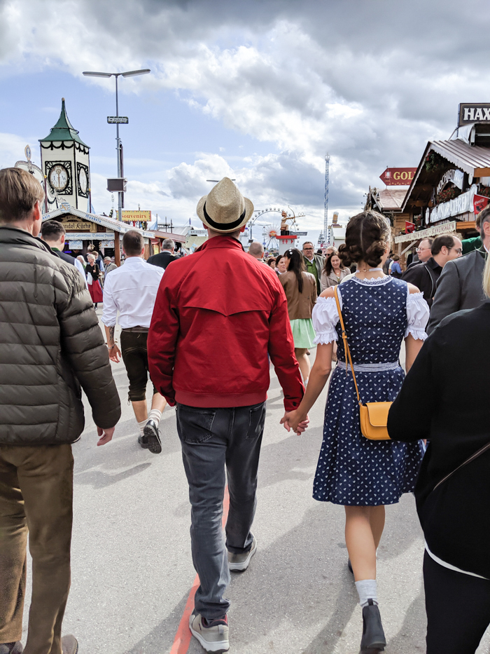 Cute couple at Oktoberfest | How to dress for Oktoberfest, a Complete and Honest Oktoberfest Packing Guide for dirndls | What to wear to Oktoberfest in Munich, Germany #oktoberfest #dirndl #munich #germany #festival #beerfestival