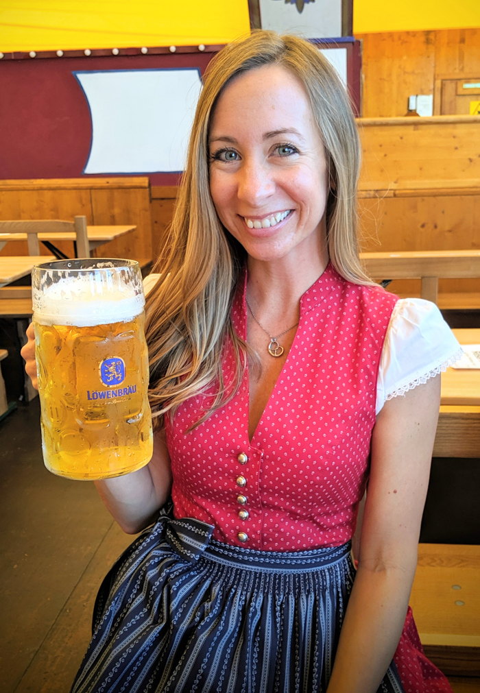 red high neckline dirndl | How to dress for Oktoberfest, a Complete and Honest Oktoberfest Packing Guide for dirndls | What to wear to Oktoberfest in Munich, Germany #oktoberfest #dirndl #munich #germany #festival #beerfestival