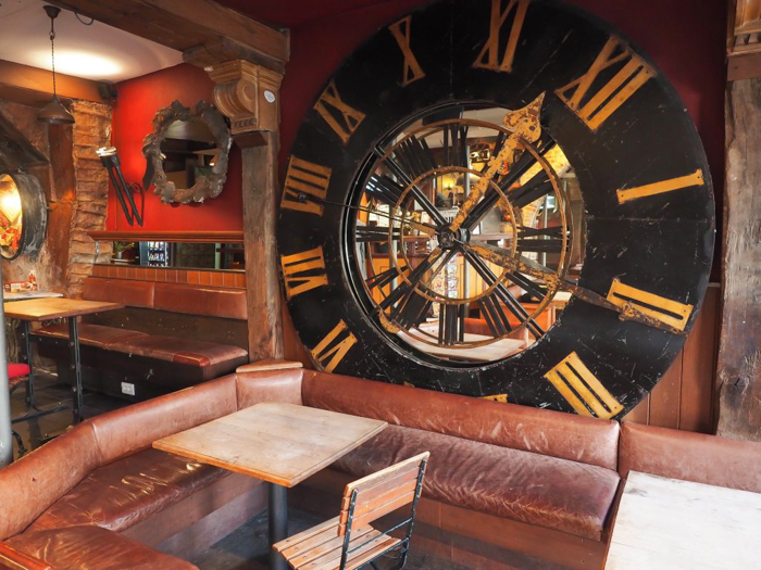 Lobby / reception area at St. Christopher's Inn Bruges, Belgium | Hostel at the Bauhaus | Brugge | giant clock