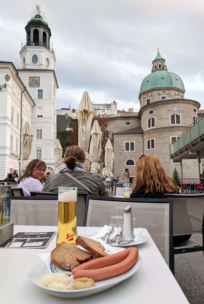 How to Squeeze in a Day Trip to Salzburg from Munich | Austria to Germany | Sound of music, mozart, castle, brewery, museums #salzburg #austria #thesoundofmusic #beer #mozart #daytrip #castle | Mozartplatz, vienna sausages