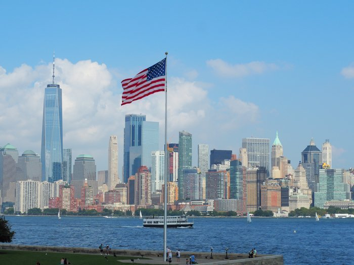 A Time-Budget Traveler's Guide to Visiting Ellis Island in a Hurry   New York City, Manhattan and the Statue of Liberty   United States Immigration Museum   National Park Site #ellisisland #newyorkcity #stateofliberty #nyc #manhattan #ushistory american flag