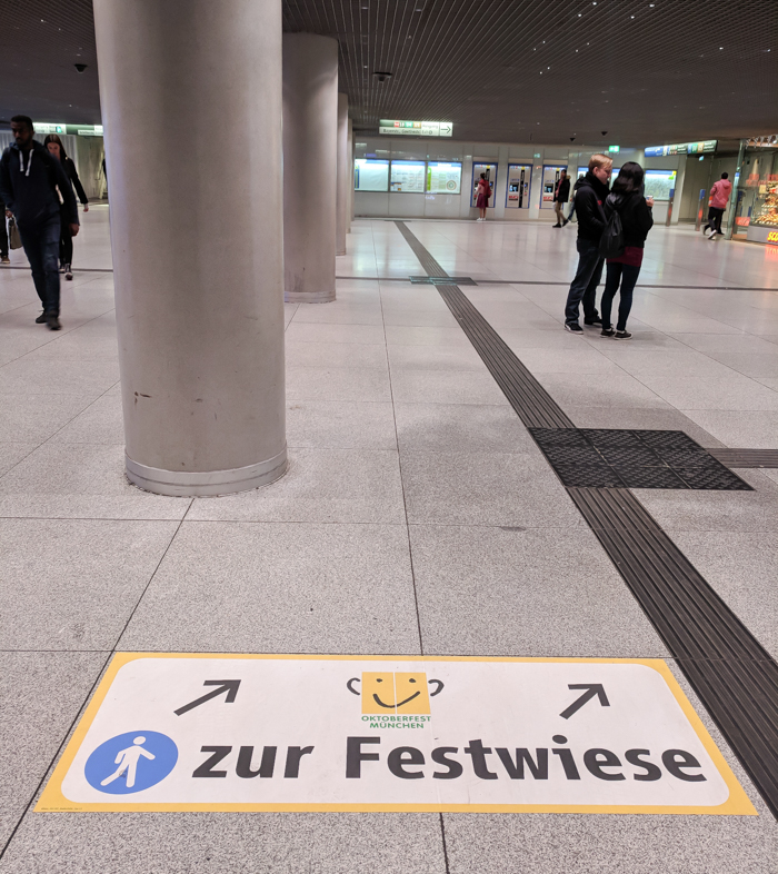 Munich train station oktboerfest sign / Must-Know Oktoberfest tips from an Oktoberfest tour guide and locals / what you need to know about oktoberfest in munich, germany