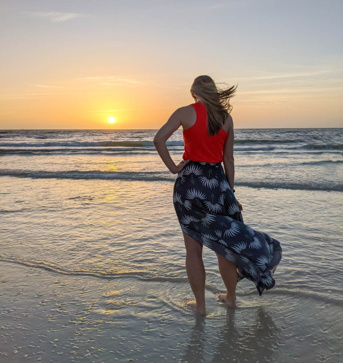 sunset over the ocean, me standing on the beach in a flowy skirt