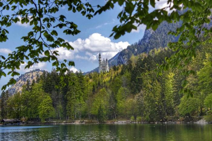Neuschwanstein Castle and lake from a distance | Where to stay near Neuschwanstein Castle: 12 Best Hotels and Airbnbs in Hohenschwangau, Schwangau, and Füssen