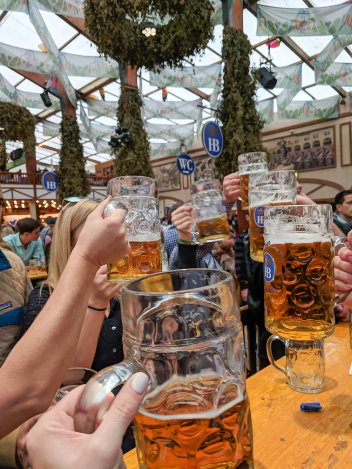 prosting Oktoberfest beers | Will Oktoberfest 2021 take place? Is Oktoberfest 2021 going to be canceled? All the info you need to know like what to do, how to plan ahead, official announcements out of Munich, Germany