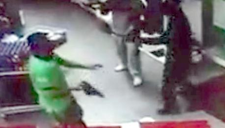 Brave shop worker fights off armed raiders