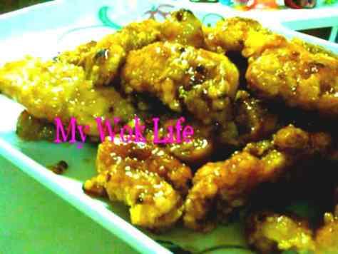 Fried fish fillet in lemon sauce