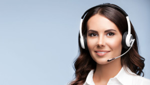 Female customer support phone operator in headset