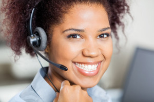 36965805 - happy female customer service representative wearing headset