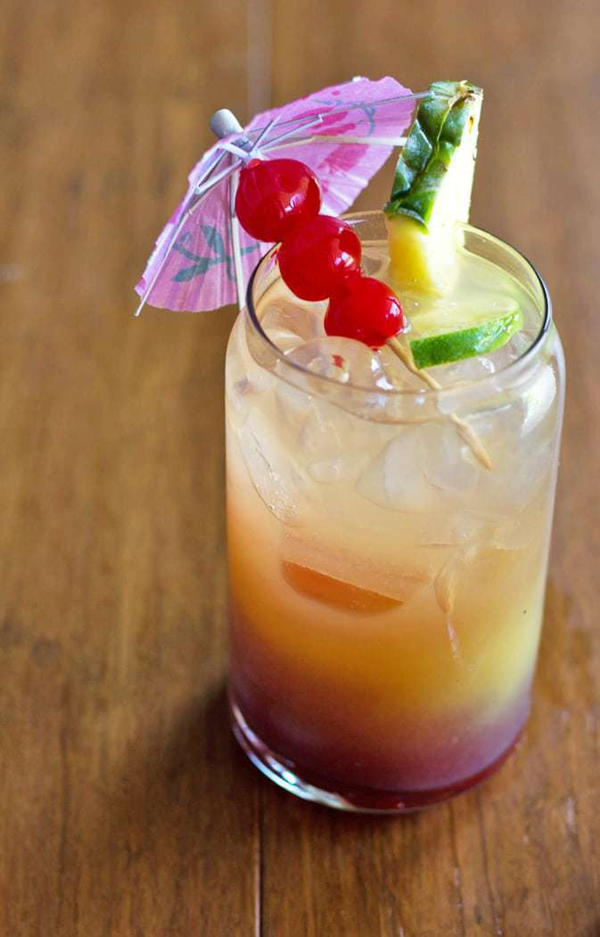 The Tropical Summer Rum Punch is a light, refreshing and delicious summer cocktail!