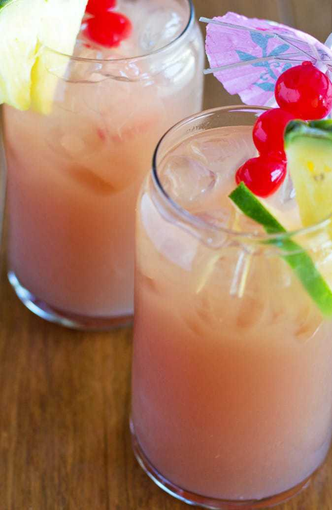 This Tropical Summer Rum Punch will cool you down on a hot summer day and take you to a tropical island in your mind!