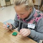 Abby at Tech Night - Building her Pixie Kit