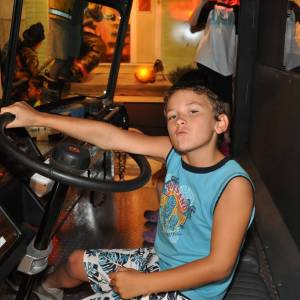 A boy is driving a vehicle.