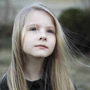 Young girl standing outside and thinking