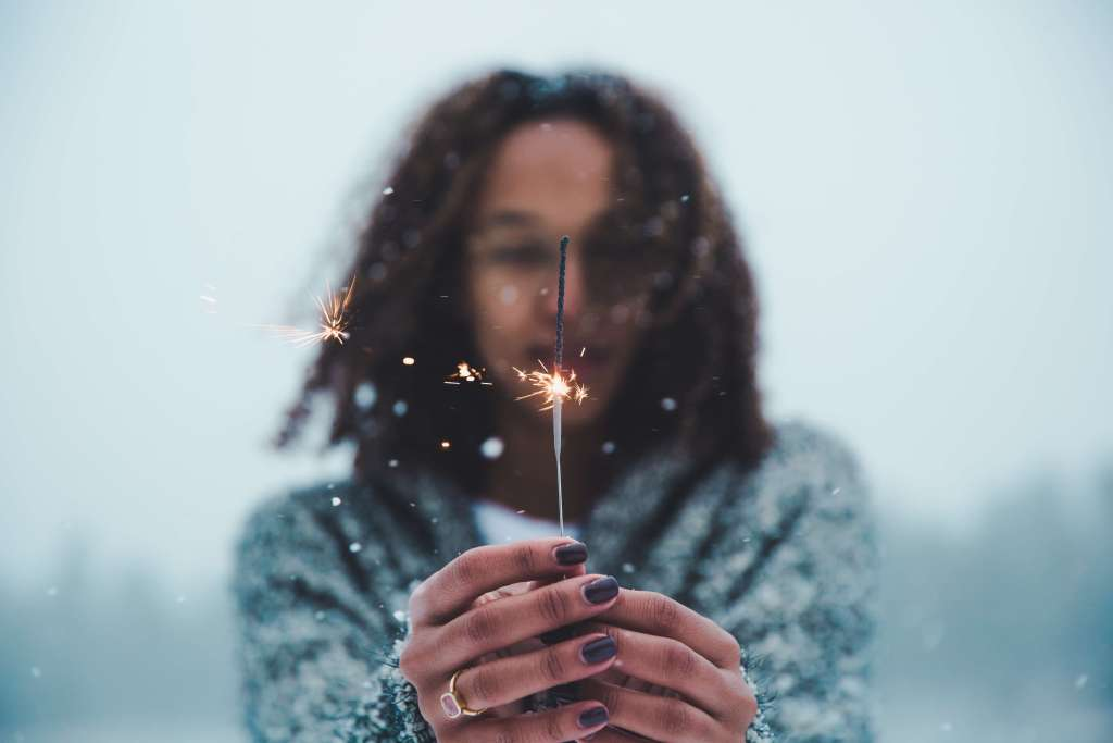 Teenage girl with sparkler