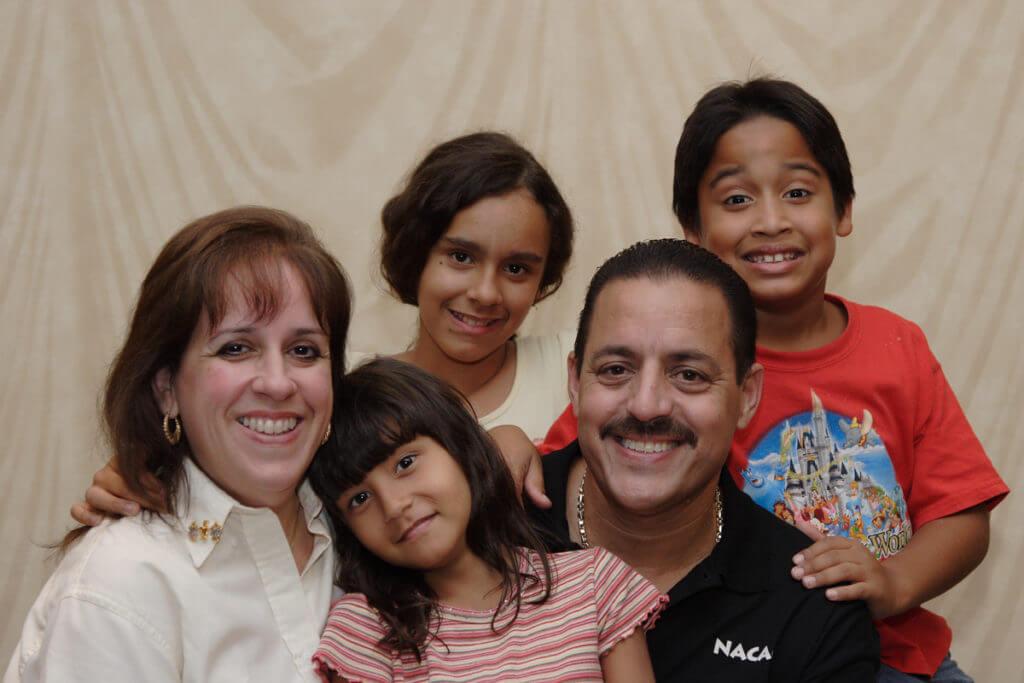 Parents with three children