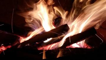 blazing fire at night outside