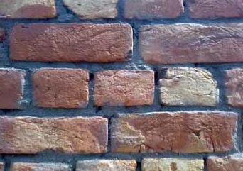 Header bricks in a solid brick wall