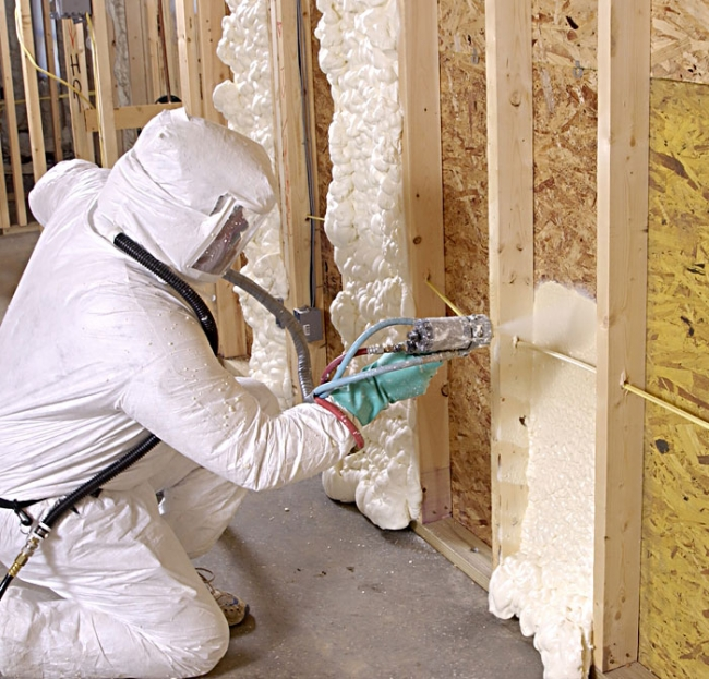 Soy-based insulation is applied with a water spray