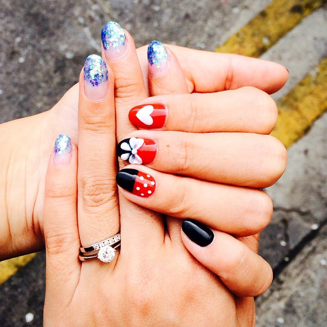 "Both @theiceangel's and my nails done by @millysbeautysg! Mickey themed nails for her and simple gelish for me! quote ""nadnut"" to enjoy special discounts! Sms 8383 5395 for appointments!"