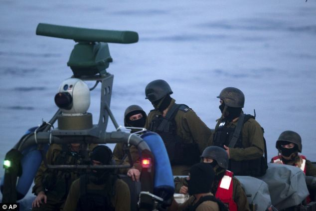 Daily Mail photo os masked Israeli military personnel after raid on Gaza ships