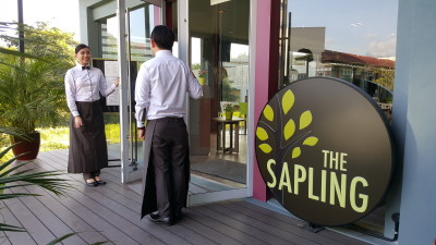The Sapling, SHATEC Training Restaurant - Entrance with Students at the door welcoming guests