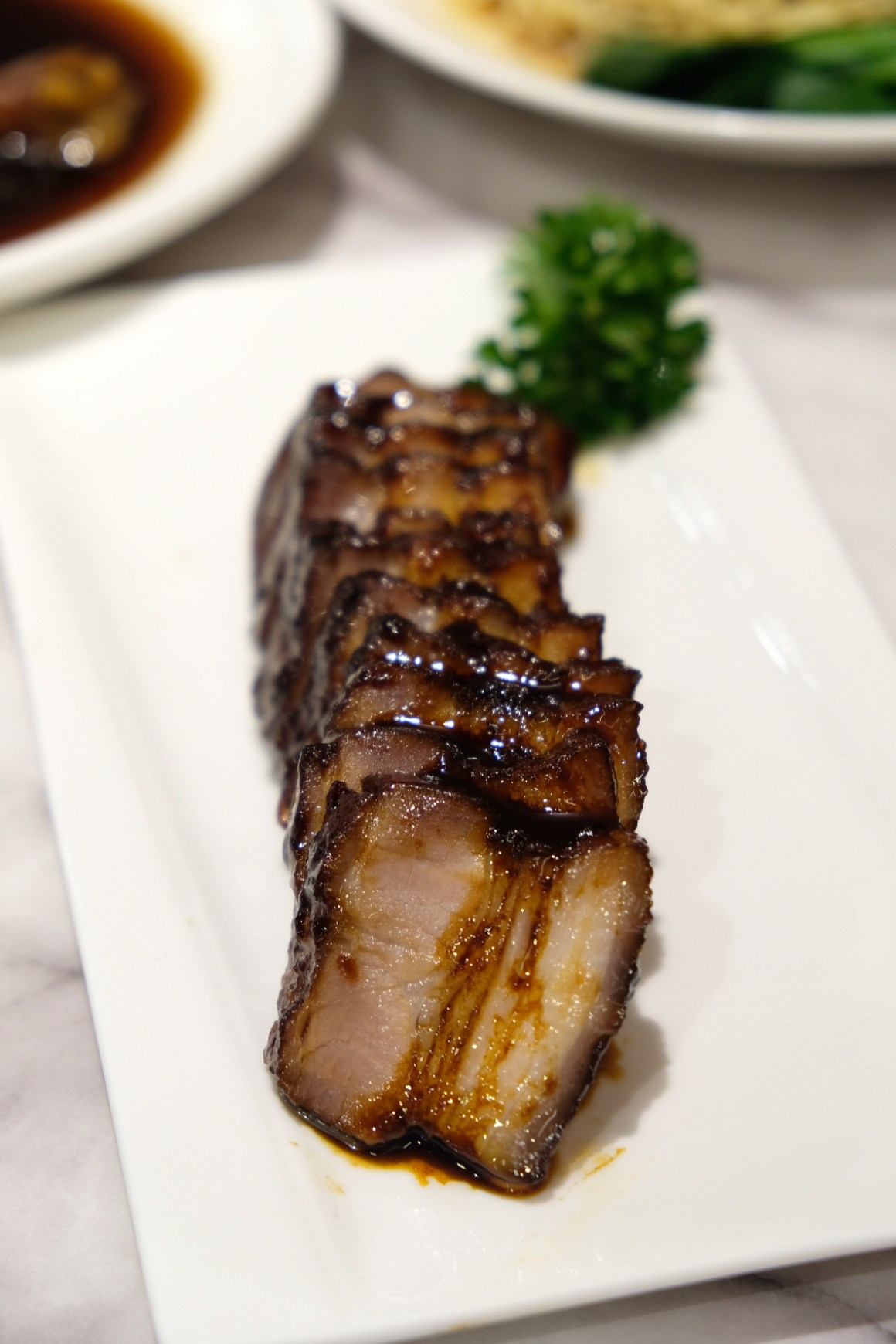 Ho Fook Hei Soy Sauce Chicken By Joyden At Great World City - Honey-Glazed Black Barbeque Pork Belly ($13)