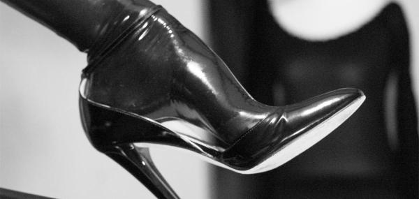 Latex stockinged feet in black high heels