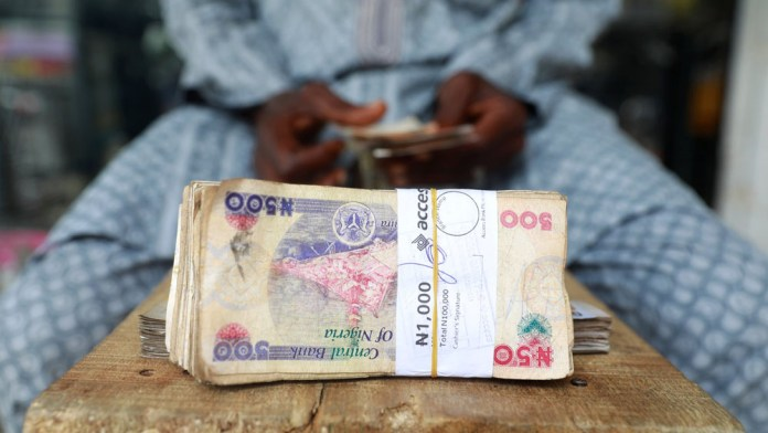 EXPLAINER: Why Nigeria's central bank won't ease its grip on the naira