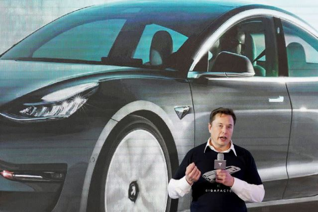 Tesla customers can now buy electric vehicles with bitcoin, Elon Musk says