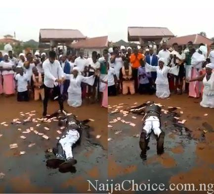 Hillarious Drama As Pastor Rolls In Engine Oil While Members Spray Money On Him During Crusade (Video)