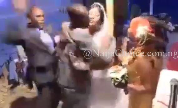 Drama As Groom Drags Best Man Away From His Wife, Hits Him For Hugging Her Tightly (Video)