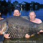 Man Poses With Monster Fish He Caught In A Lake (Photo)