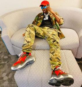Zlatan Ibile shows off the camouflage jacket he bought for over 600k