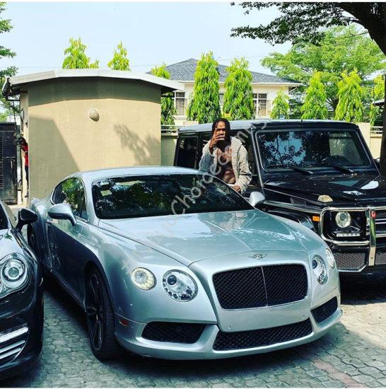 Photos of the exoctic cars in Naira Marley's garage