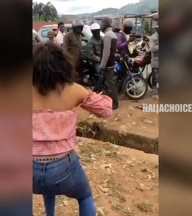 Lady Jumps Down From A Bike And Starts Misbehaving In Ado Ekiti (Video)