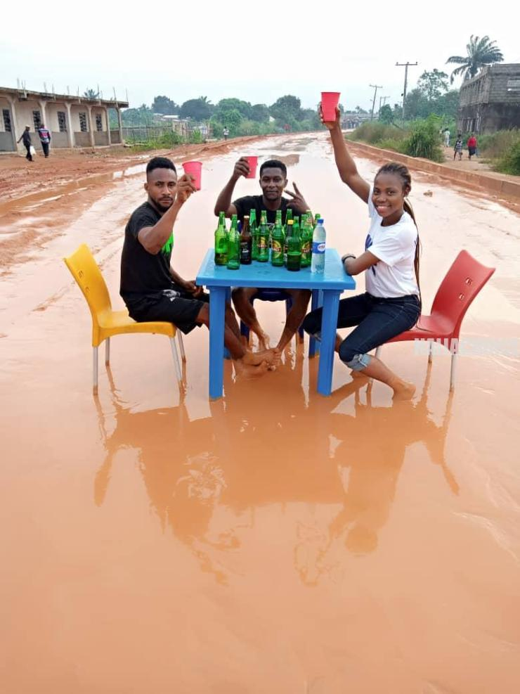 #EndBadGovernance: Youths Drink Beer On A Bad, Muddy Road In Owerri (Photos)