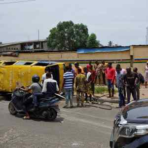 A Commercial Bus Summersaults In Lone Accident In Ikeja (Pictures)