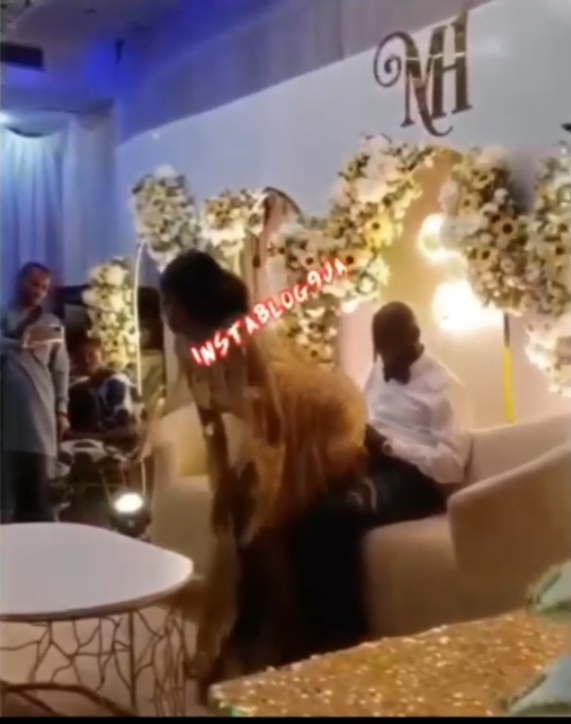 Actress Olayinka Solomon Grinds Her Husband At Their Wedding Reception (Pics, Video)