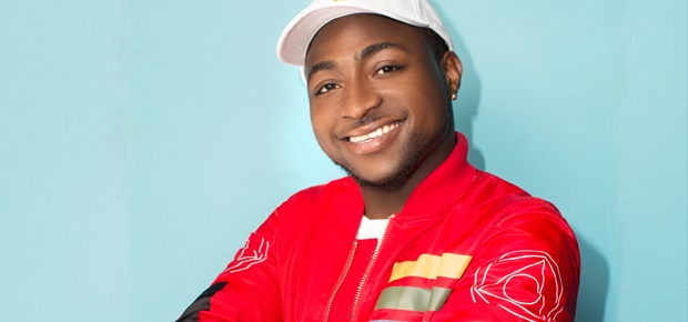 Picture of Davido in red sweaters and a white baseball cap