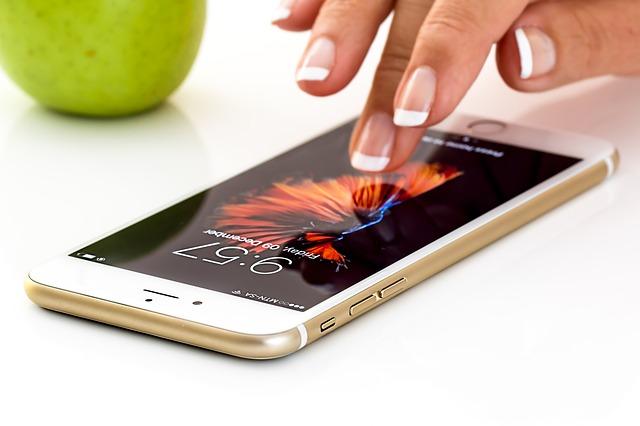 A female hand operating a smartphone