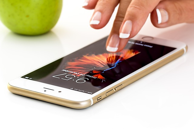 A female hand operating a smartphone