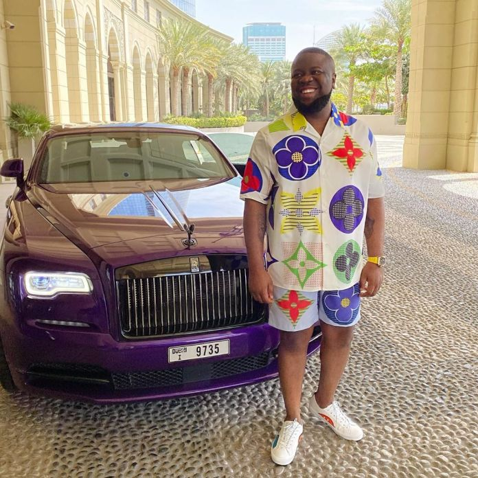 Ray stands in front of his customized Rolls Royce Wraith.
