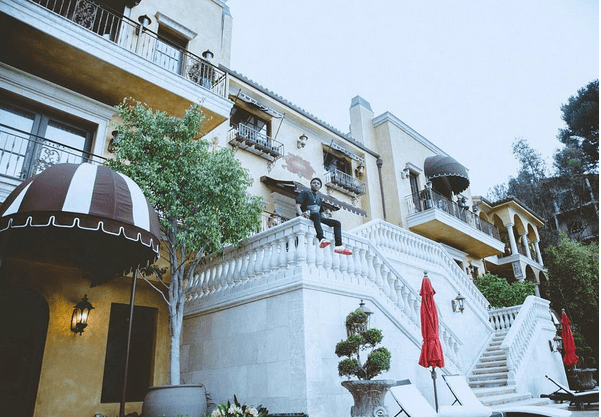 Wizkid enjoys a good view from the front staircase of his Los Anageles home.