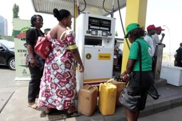 A fuel station attendant dispenses kerosene at a Nigerian National Petroleum Corporation (NNPC) mega petrol station in Abuja