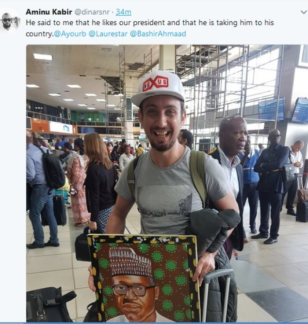 man2 1 - Oyinbo Man Spotted With Buhari's Painting At Lagos Airport   See What He Said